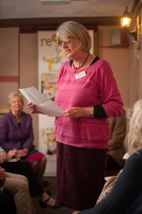 Photo of Mari Howard reading before an audience