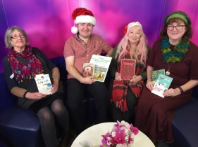 The Four of us writers, in Christmas mood on the sofa!