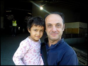 Syrian refugee child and Paul Alkazraji.
